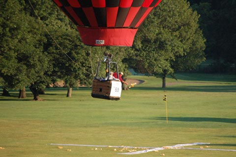 Hot Air Balloon Pilot tossing marker at target